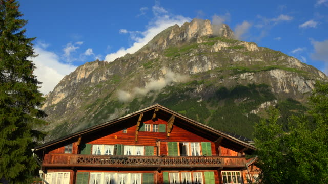 chalet and mettenberg, grindelwald, bernese oberland, canton of bern, switzerland - chalet stock videos & royalty-free footage