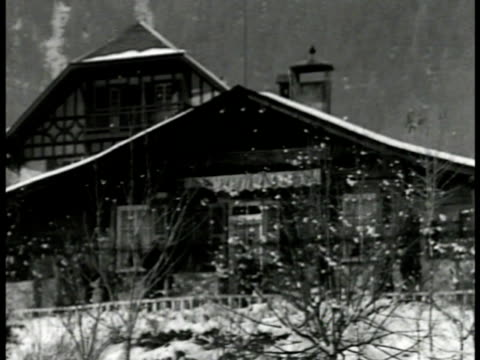stockvideo's en b-roll-footage met chalet in alpine region la ms lantern water pipe snowcap mountain bg ms chalet int vs fascist italy dictator benito mussolini sitting by fireplace cu... - benito mussolini