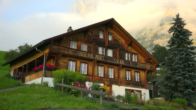 chalet near grindelwald and wetterhorn, bernese alps, switzerland, europe - chalet stock videos & royalty-free footage