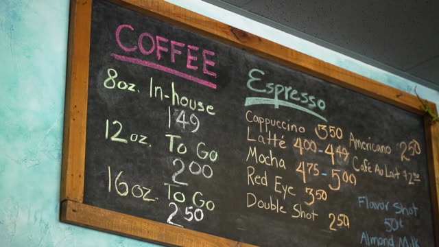 chalk board menu at coffee roaster shop - hanging sign stock videos and b-roll footage