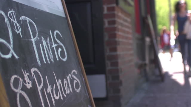 chalkboard outside restaurant has price for pints and pitches written on it. - jug stock videos & royalty-free footage