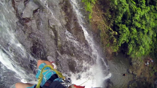 challenge going down the waterfalls rappelling - free falling stock videos & royalty-free footage
