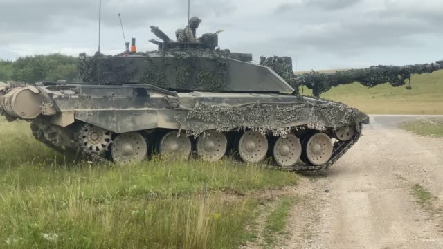 challenger 2 main battle tanks from the queen's royal hussars during a training exercise on salisbury plain training area on july 03, 2020 in... - carro armato video stock e b–roll