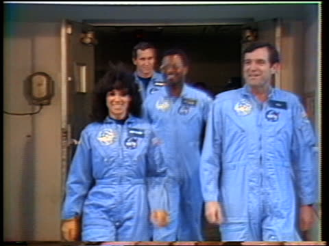 challenger astronauts in flight suit exiting thru doorway entering van before flight - 1986 stock-videos und b-roll-filmmaterial