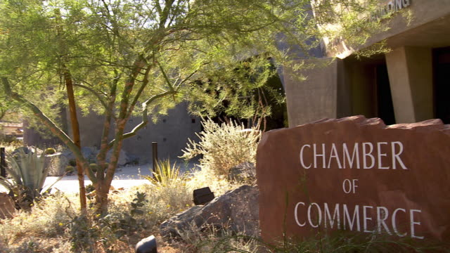 ws pan chamber of commerce sign carved into natural stone outside palm desert henderson community center / palm desert, california, usa  - community center stock videos and b-roll footage