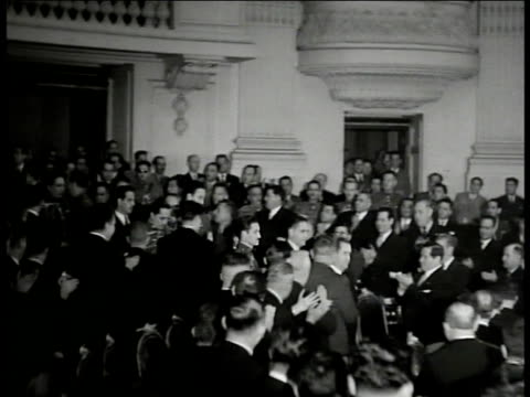 Chamber of Deputies building INT WS President Manuel A Camacho walking through room legislative members standing clapping VS Camacho to stand at...