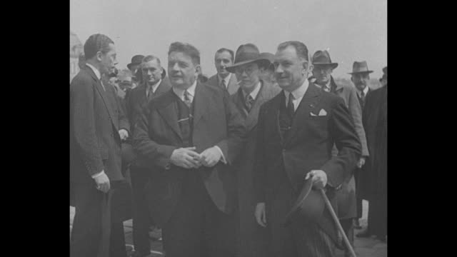 ext chamber of deputies in paris / former french prime minister edouard herriot walks with crowd / prime minister joseph paulboncour shakes hands... - quartier de la bourse stock-videos und b-roll-filmmaterial