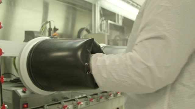 a chamber with several black glove slots on the side for scientists arms in michigan state university in east lansing michigan on march 23rd 2015... - lansing stock videos and b-roll footage