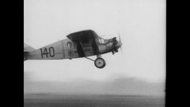 stockvideo's en b-roll-footage met chamberlin and devine make record nonstop transatlantic flight from roosevelt field long island to eisleben germany / 1953 clip of clarence... - 1927