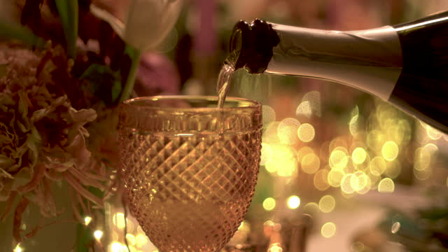 cu of champagne being poured into glass - refreshment stock videos & royalty-free footage