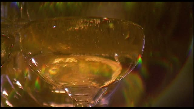 cu - champagne being poured into overflowing glass - full stock videos & royalty-free footage