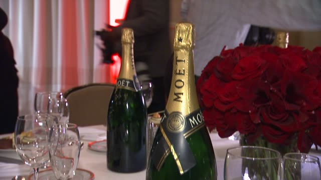 atmosphere champagne bottle and table at the beverly hilton unveils menu for 70th annual golden globe awards atmosphere champagne bottle and table at... - the beverly hilton hotel stock videos & royalty-free footage