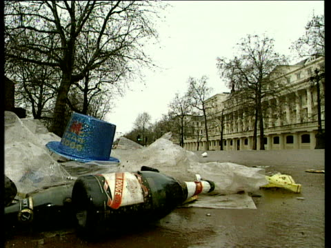 Champagne bottle litter and party hat lie in gutter after Millennium celebrations The Mall 01 Jan 00