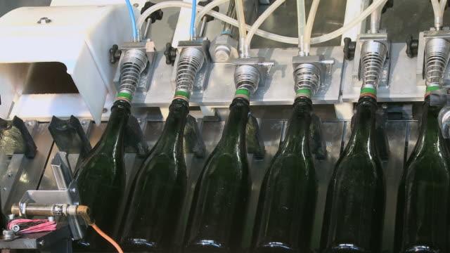 CU Champagne bottles on production line / Wiltingen, Saar-Valley, Rhineland-Palatinate, Germany