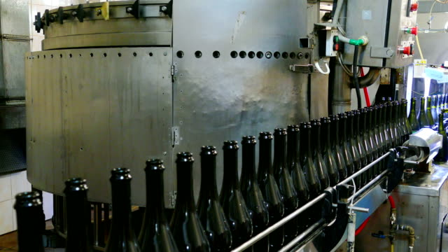 champagne bottling line in the factory - bottling plant stock videos and b-roll footage