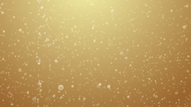 champagne bubbles rising - gold colored stock-videos und b-roll-filmmaterial