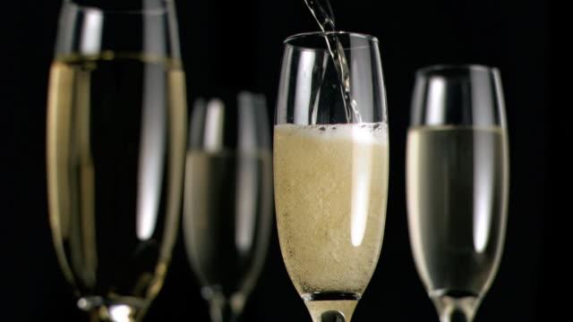 champagne flowing in super slow motion - sektkorken stock-videos und b-roll-filmmaterial