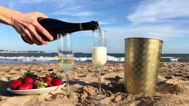 Champagne pour on beach