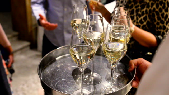champagne glasses on tray - high society stock videos & royalty-free footage