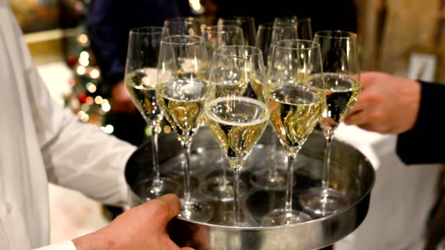 champagne glasses on tray - service stock videos & royalty-free footage