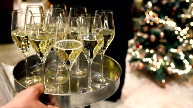 champagne glasses on tray - stereotypically upper class stock videos & royalty-free footage
