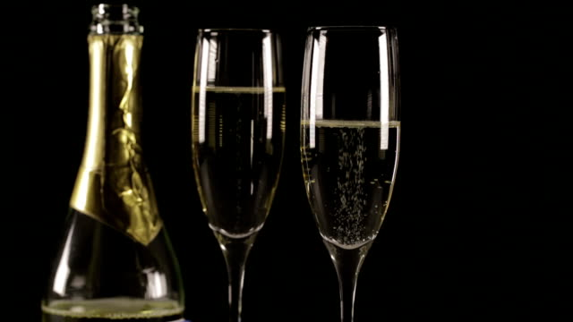 champagne glasses with bottle hd - champagne flute stock videos & royalty-free footage