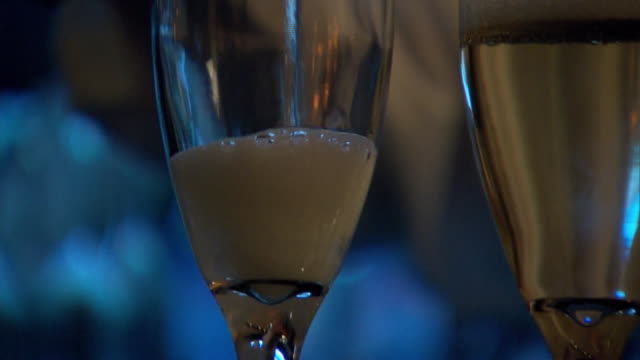 stockvideo's en b-roll-footage met champagne is served at the 75th annual golden globe awards post-party at the beverly hilton hotel in california. - healthcare and medicine or illness or food and drink or fitness or exercise or wellbeing
