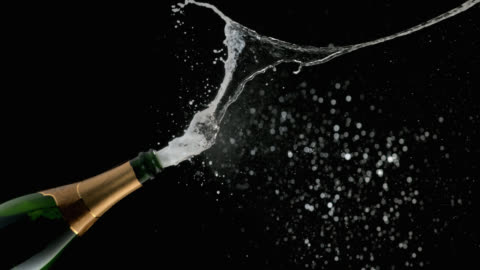 stockvideo's en b-roll-footage met slo mo of champagne popping and the bubbles spraying - black background