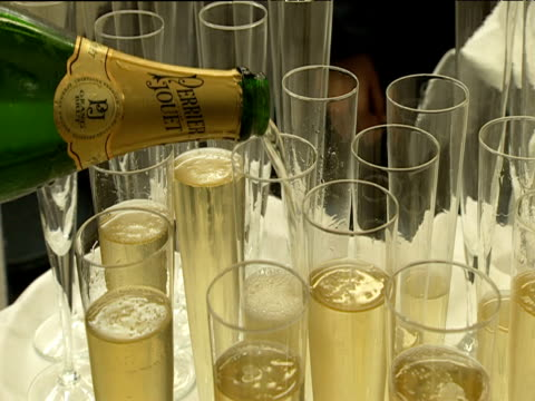 champagne poured into flute glasses on tray - 2000s style stock videos & royalty-free footage