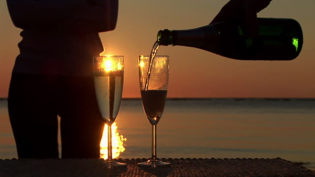 hd: champagne the sunset - champagne flute stock videos and b-roll footage