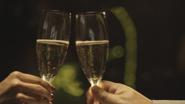 champagne toast slow motion - drinking glass stock videos & royalty-free footage