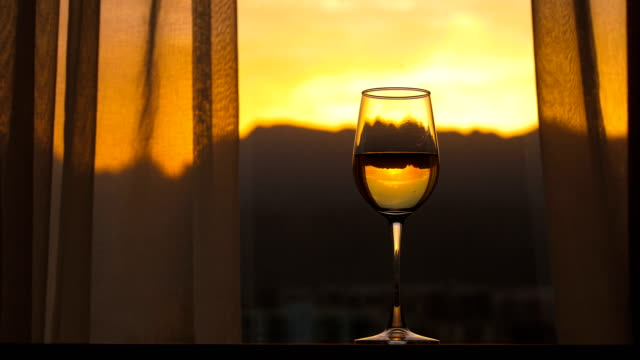 Champagne with window sunset background