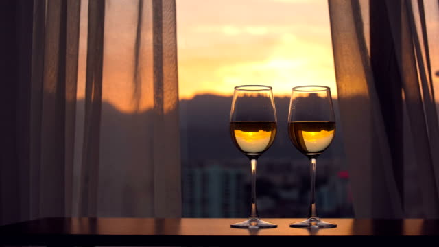 champagne with window sunset background - balcony stock videos & royalty-free footage