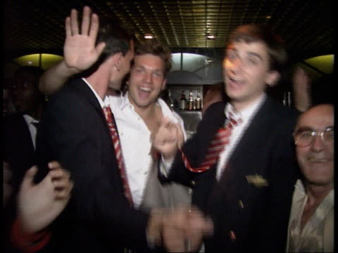Champions Arsenal return home EXT/NIGHT London Highbury MS Alan Smith towards off coach and past as patted by fans MS Tony Adams towards off coach...
