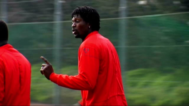 Arsenal squad training ENGLAND Hertfordshire London Colney EXT Arsene Wenger talking to Nicklas Bendtner Emmanuel Adebayor and Emmanuel Eboue walking...