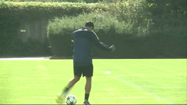 arsenal v montpelier preview 1792012 england hertfordshire london colney ext arsene wenger along pitch at training session wenger kicking football to... - モンペリエ点の映像素材/bロール