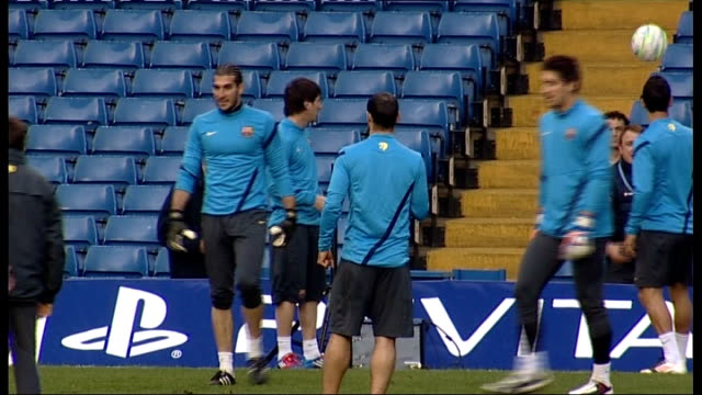 Barcelona Training at Stamford Bridge ENGLAND London Stamford Bridge EXT Barcelona players training on pitch including Javier Mascherano Lionel Messi...