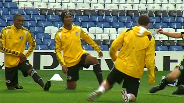 Chelsea squad training Terry and Ashley Cole stretching Didier Drogba training Hiddink and coaches More generic shots of Chelsea squad training Petr...