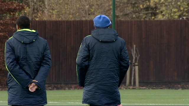chelsea train ahead of their match against msk zilina england surrey cobham ext back view carlo ancelotti and michael emenalo watching chelsea... - cobham surrey stock videos and b-roll footage