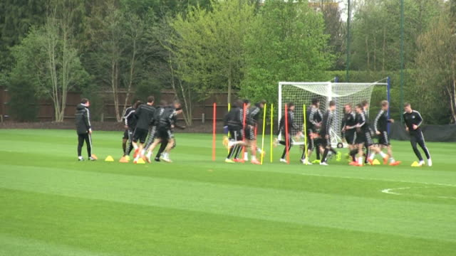 Chelsea training session ahead of second leg match against PSG ENGLAND Surrey Cobham EXT Wide shot Jose Mourinho with member of coaching staff in...