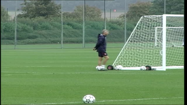 Arsene Wenger watching team on training pitch Arsenal squad on training pitch