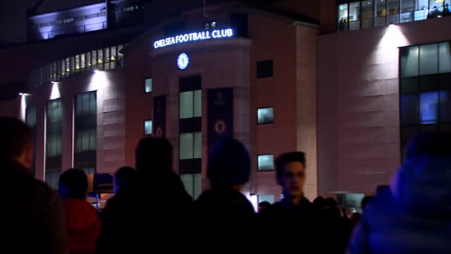 stockvideo's en b-roll-footage met west london chelsea stamford bridge chelsea fans along from underground station fans arriving outside club souvenirs on stall 'chelsea v paris sg'... - kensington en chelsea