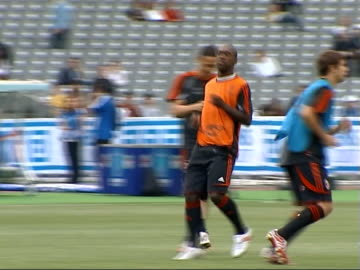 champions league final: ac milan training session; more of ac milan training session doing stretching exercies and running the length of the pitch - length stock videos & royalty-free footage