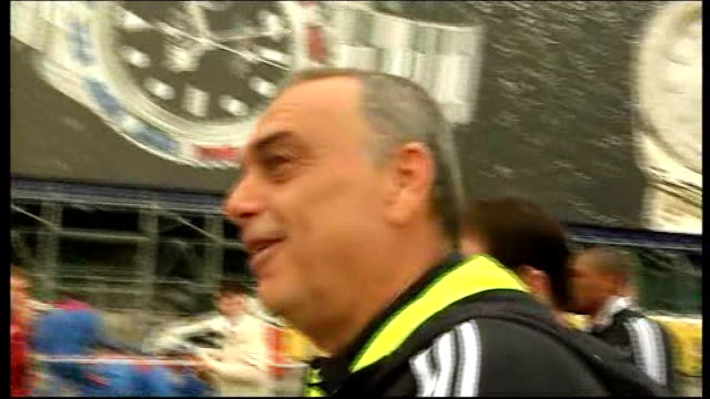 Avram Grant arrives in Red Square RUSSIA Moscow Red Square EXT Avram Grant along with other Chelsea FC officials as speaks to reporter and waves to...