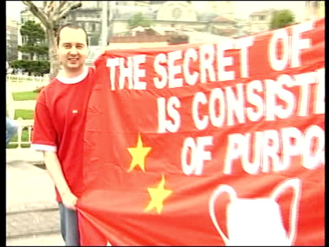 buildup turkey istanbul liverpool fan holding one side of banner pull out to show banner in full 'the secret of success is consistency of purpose'... - 2005 stock videos & royalty-free footage