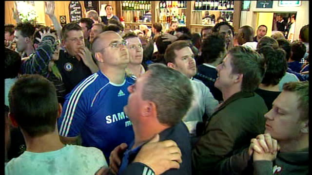 Chelsea and Manchester United fans live reactions in UK ENGLAND London INT Reaction of Chelsea fans watching Champions' League final in pub during...