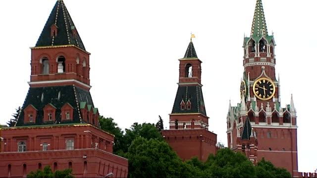 Fans and riot police RUSSIA Moscow Red Square EXT General views of St Basil's Cathedral and ornate towers/ red brick towers / UEFA Champions Festival...