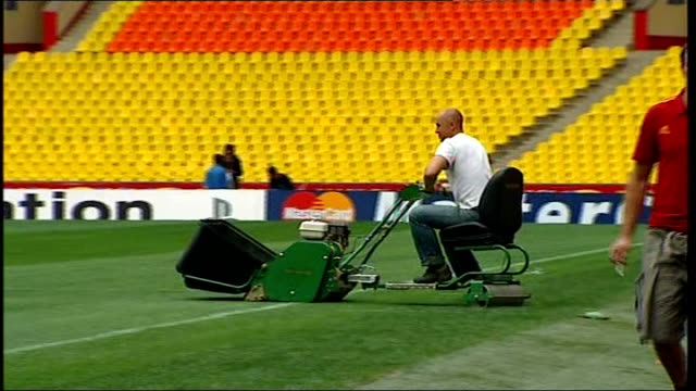 fans in Moscow city centre / interiors of Luzhniki Stadium Luzhniki Stadium Groundsman along on roller machine on pitch / Grass on pitch / More of...
