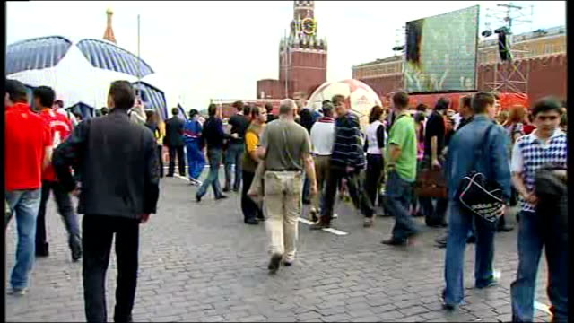 fans in moscow city centre / interiors of luzhniki stadium woman showing manchester united scarf / more of fans in red square / pedestrians along... - luzhniki stadium stock videos & royalty-free footage