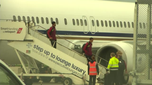 Liverpool team return to UK after defeat to Real Madrid ENGLAND Liverpool Liverpool John Lennon Airport EXT Liverpool players disembarking plane and...